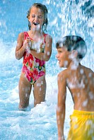 Close-up of a boy and a girl in a swimming pool