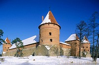 Gothic castle built XIV-XVth century, Lake Galve in winter. Trakai, Lithuania
