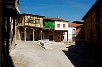Arcaded houses in Juan de Austria square, Cuacos de Yuste. Cáceres province, Extremadura, Spain