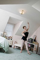 Teen girl age 17 in bedroom, ballet dancing student