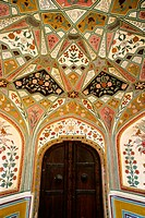 Interior, painted wall. Amber Fort. Jaipur. Rajasthan. India.