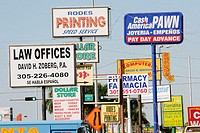 Multiple commercial signs, strip mall, advertising. 40th Street SW, Miami. Florida. USA