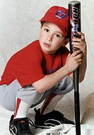 Portrait of boy squatting holding a baseball bat