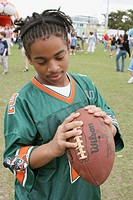 Parks and Recreation Department Youth Expo, Black male teen, football, jersey. North Shore Park, Miami Beach, Florida. USA.