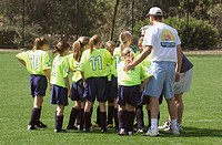coach talking with soccer team