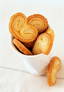 ´Pig´s ears´ (puff pastries) in a beaker