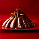 Chocolate dessert with grated chocolate on red plate