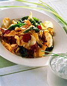 Mixed deep-fried vegetable crisps on a plate