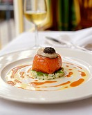 Salmon parcels with caviare on diced vegetables