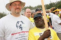 Mentally disabled, student volunteers, opening ceremonies. Special Olympics Summer Games, FIU, North Miami, Florida. USA.