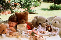 Outdoor Tea Party with Child and Teddy Bears
