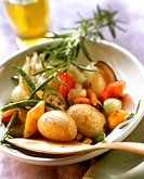 Tuscan pan-cooked potato dish with sprig of rosemary on plate