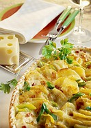 Potato bake with ham, cheese and spring onions