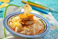 Breaded hake fillets on rice for children