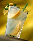 Home-made lemonade in glass with lemon wedges