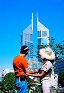 Western tourists visiting the Emirates Towers in Dubai, UAE