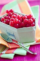 Punnet of redcurrants and spoon