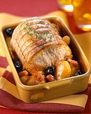 Roast pork with olives, potatoes and bacon