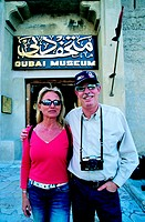 Western tourist couple in front of Dubai Museum, United Arab Emirates