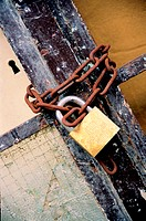 Padlock on rusty chain