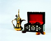 Arab traditions - dallah (Arabian coffee pot) and a box with dried dates