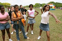 Black teens playing softball toss game, DFYIT Family Picnic in Tropical Park, Miami. Florida, USA