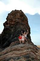 Family at a rocky beach, Terengganu, Malaysia