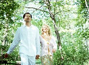 couple enjoying walk in the park (blurred image!)