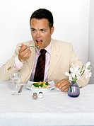 businessman in suit eating