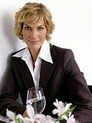 portrait of businesswoman sitting in at a restaurant table