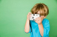 Little boy taking photo with camera
