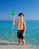 Boy paddling with fishing net (thumbnail)