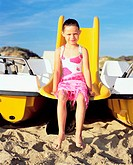 Girl sitting on a boat slide