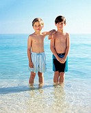 Two boys standing in the sea