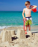 Boy with sandcastles