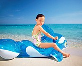 Girl on an inflatable whale
