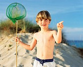 Boy holding a fishing net