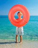 Boy holding inflatable ring