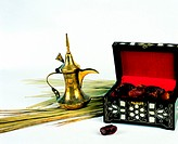 Arab traditions - box with dried dates and coffee pot (dallah)