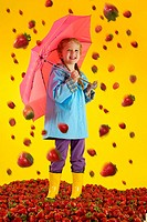 6 year old girl with strawberry rain.