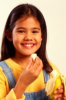 Ten-year-old American Indian girl with a banana.