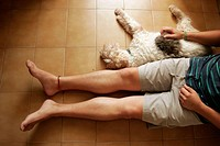Dog and its master lying on the floor.