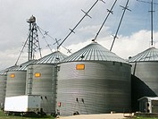 Modern grain storage bins and distribution pipes