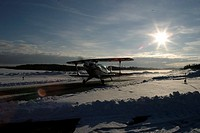 A landing airplane in winter sunshine