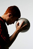 Soccer player holding ball to head (thumbnail)