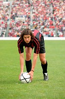 Soccer player lining up free-kick
