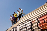 Group of teenage soccer friends on roof of tunnel (thumbnail)