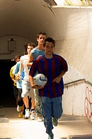 Street soccer team emerging from tunnel (thumbnail)
