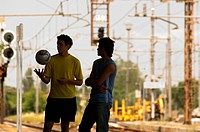 Teenage boys on station platform