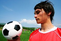 Soccer player looking at ball